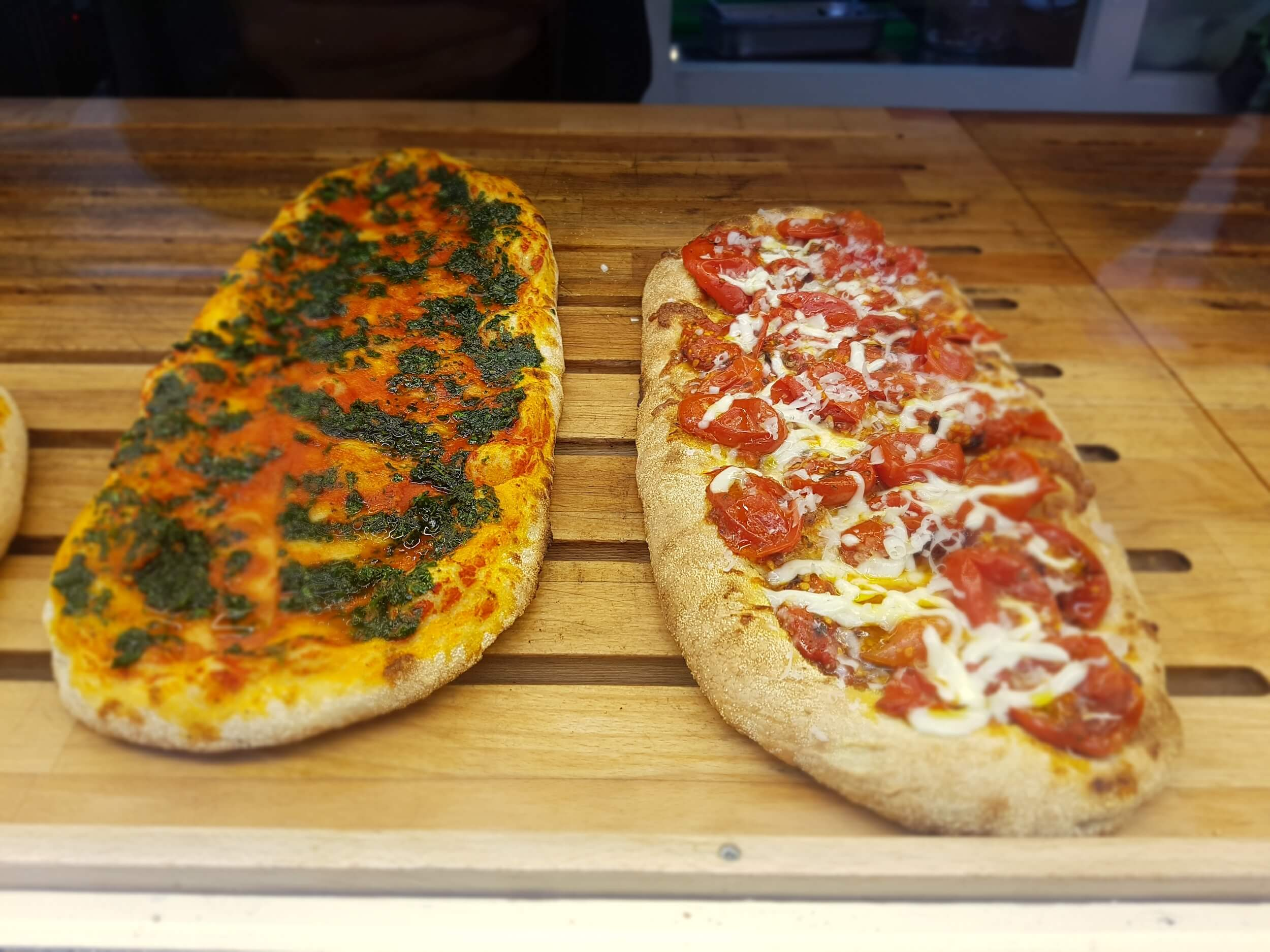 Two pizza's in display