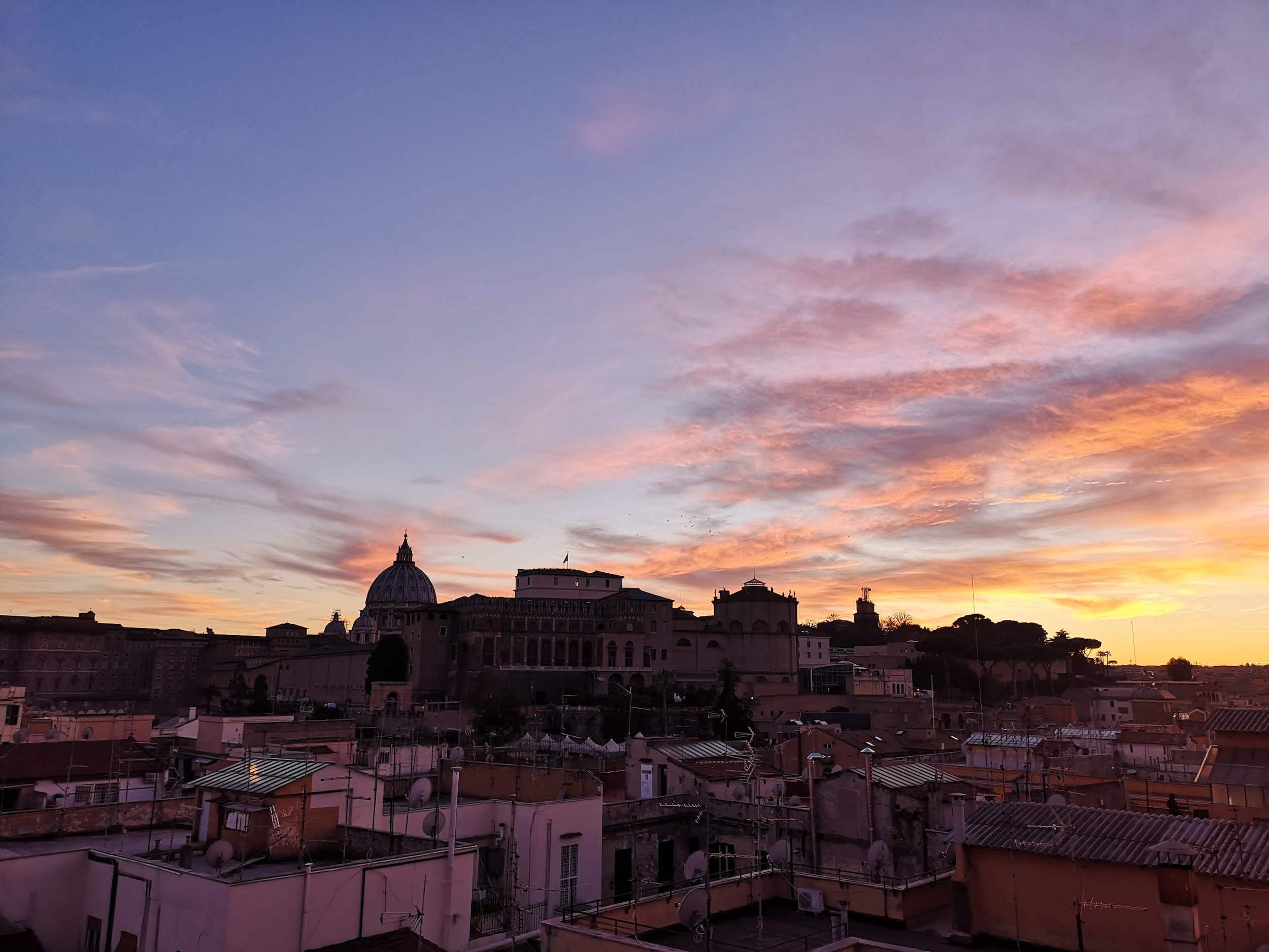 stunning sunset of Rome with St. Peters cupola on the background