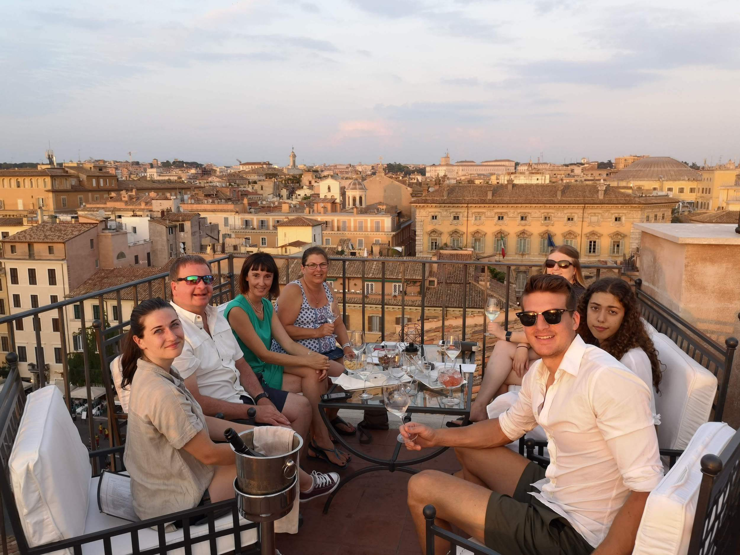 Group of people sipping wine on a wonderful terrace