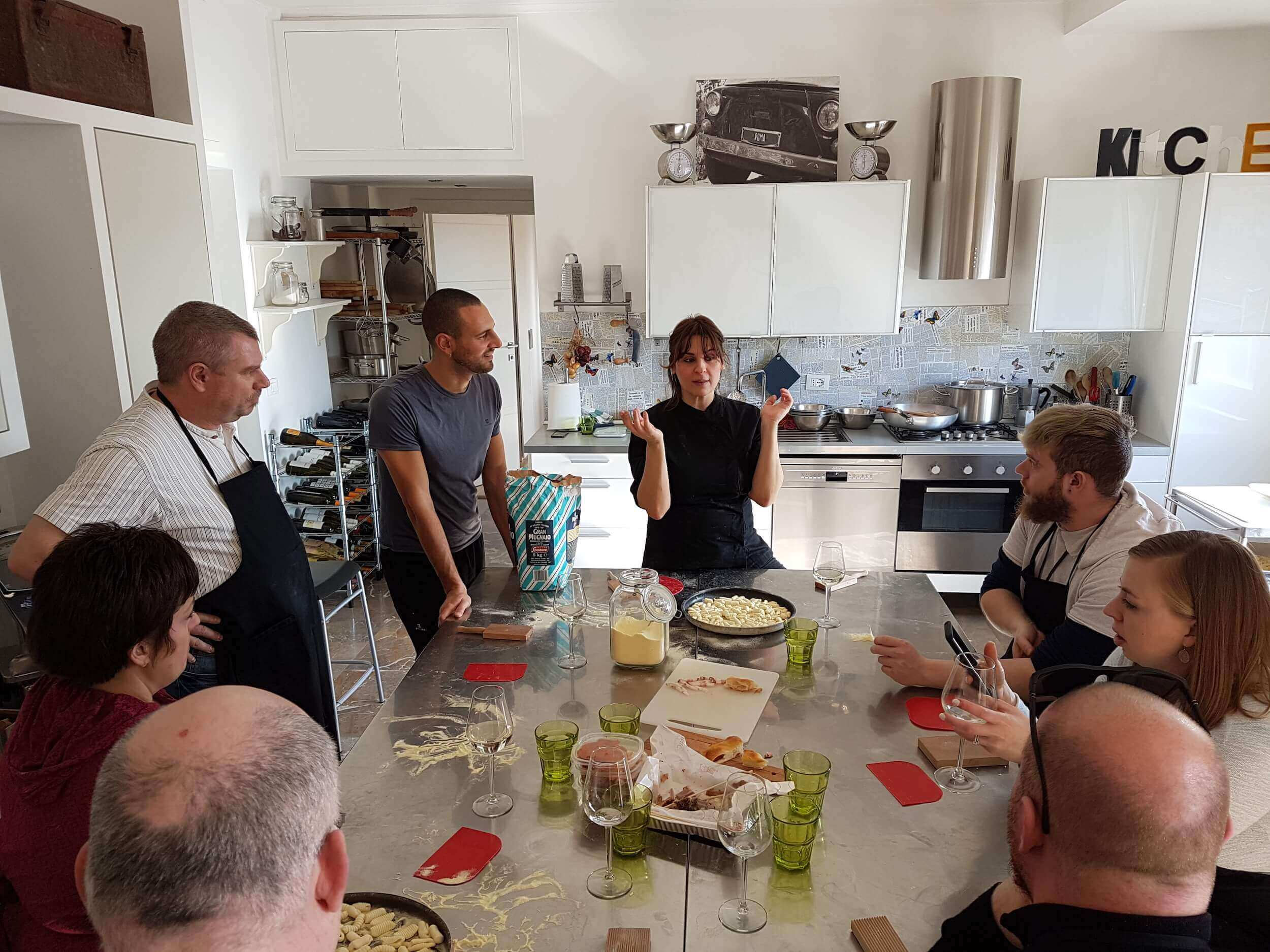 Group of people cooking in a kitchen
