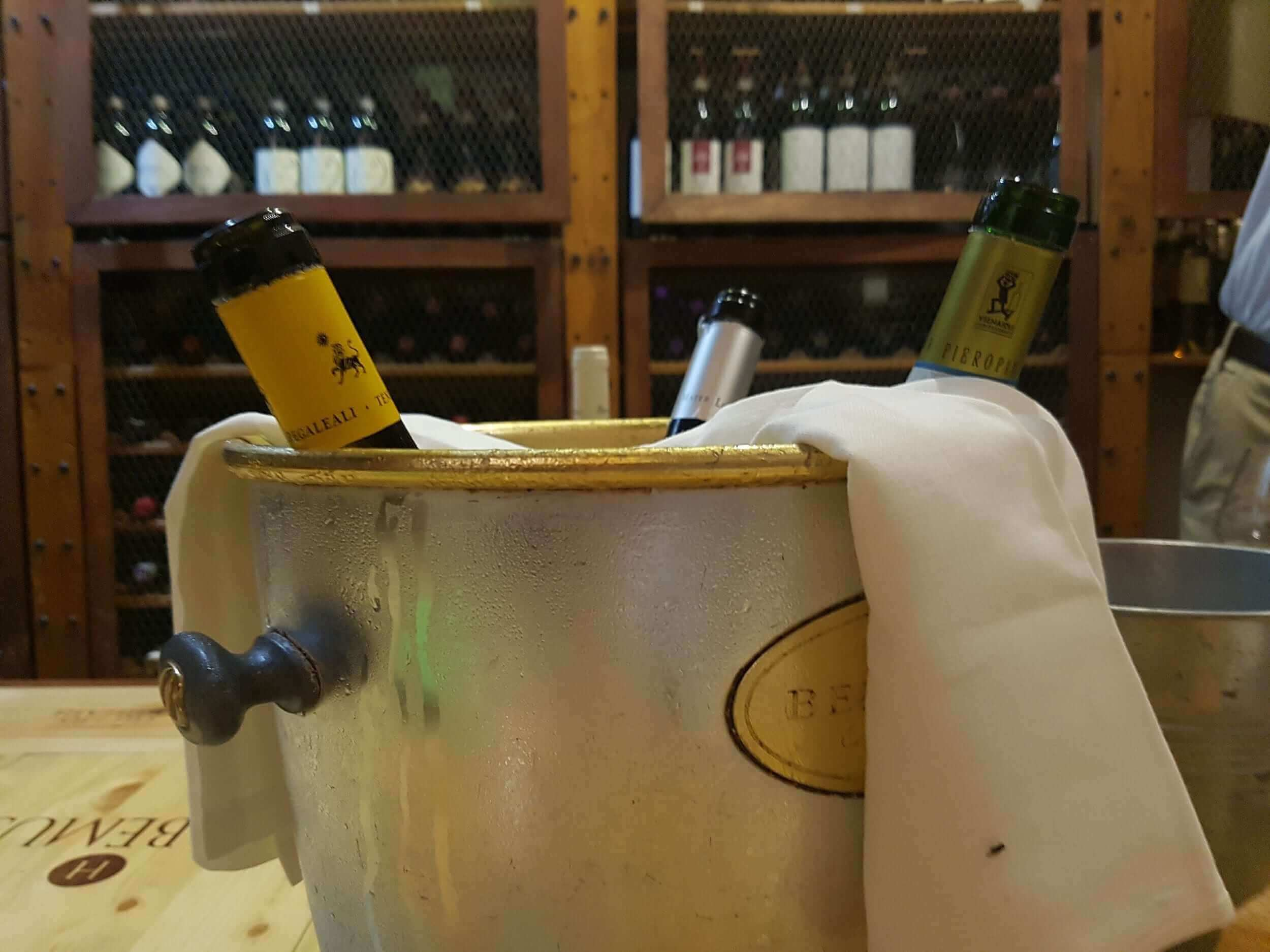 bucket of ice with prosecco bottles inside
